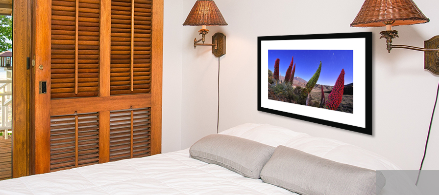 Bedroom scene with 'flowers of the Volcano' WPY wall print.