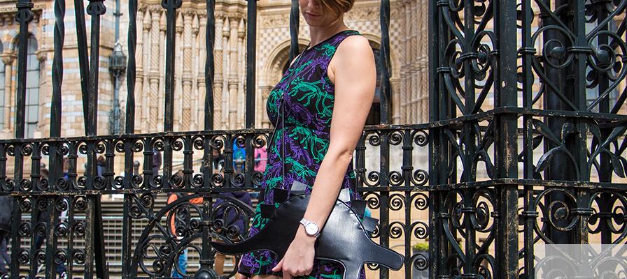 Model wearing dinosaur bones sundress in front of the Museum