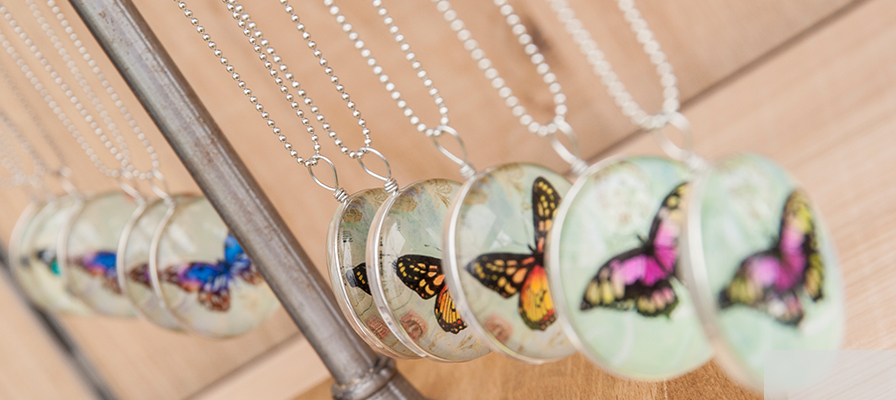 A row of butterfly necklaces