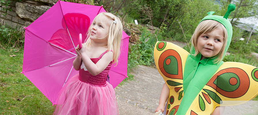 Two child models one wearing a butterfly dress, one wearing a butterfly tabard