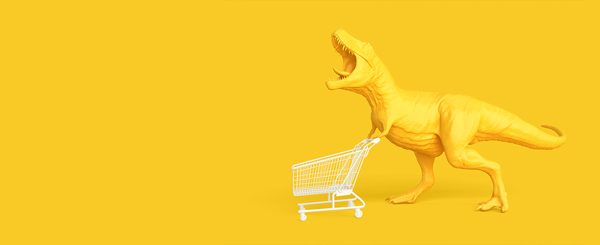 A yellow T. rex with shopping cart against a yellow background