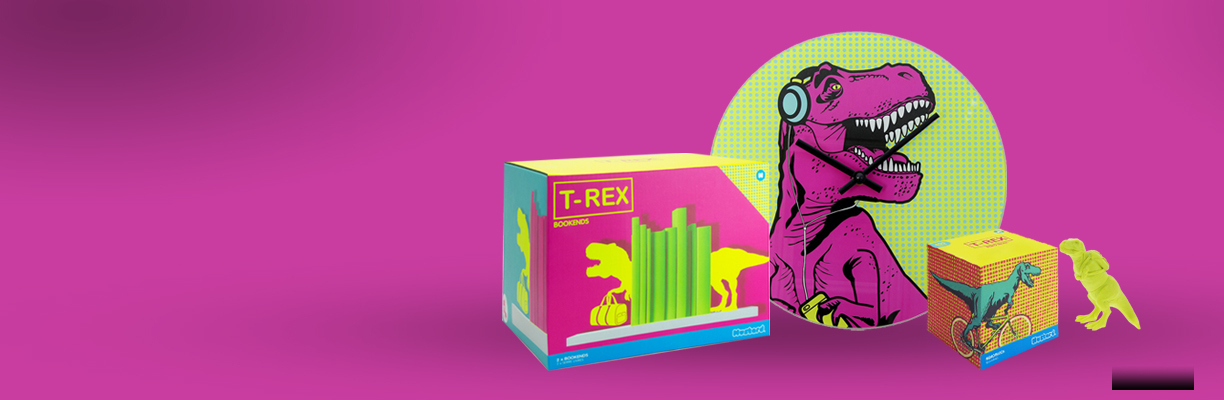 T. rex bookends, clock, notepad block and highlighter in front of a pink background