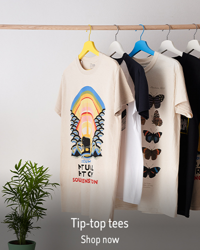 """A rail of T-shirts and a house plant. The caption reads """"Tip-top tees"""""""