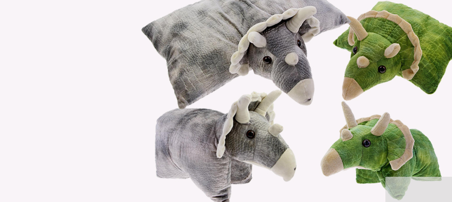 a grey and green Triiceratops pillow