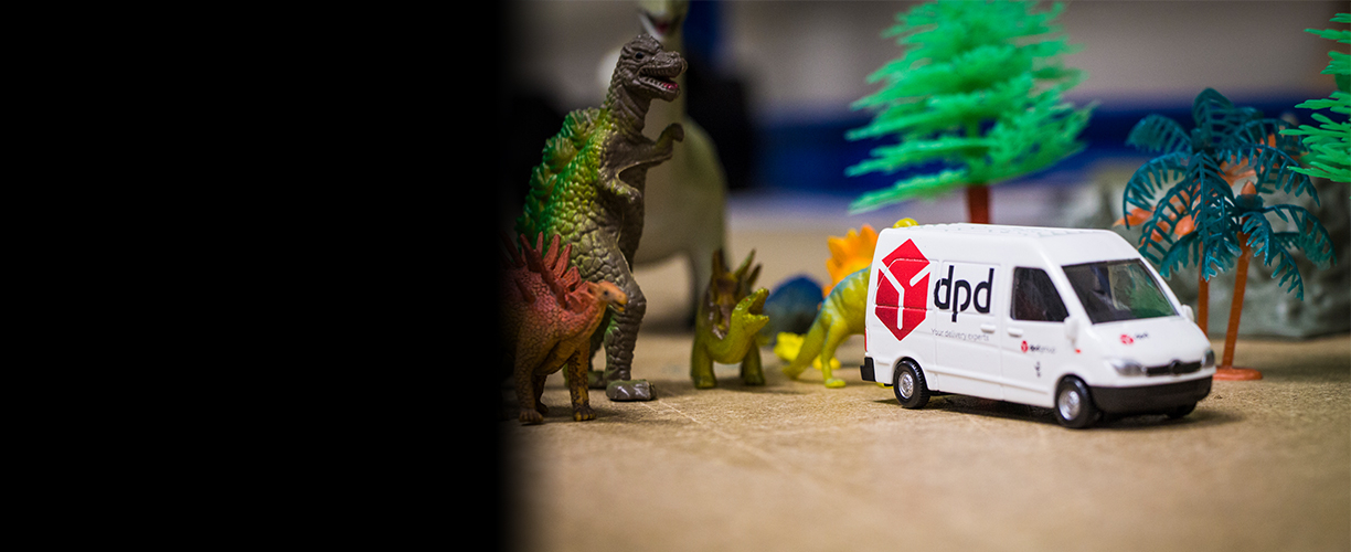 Dinosaur models next to DPD delivery van