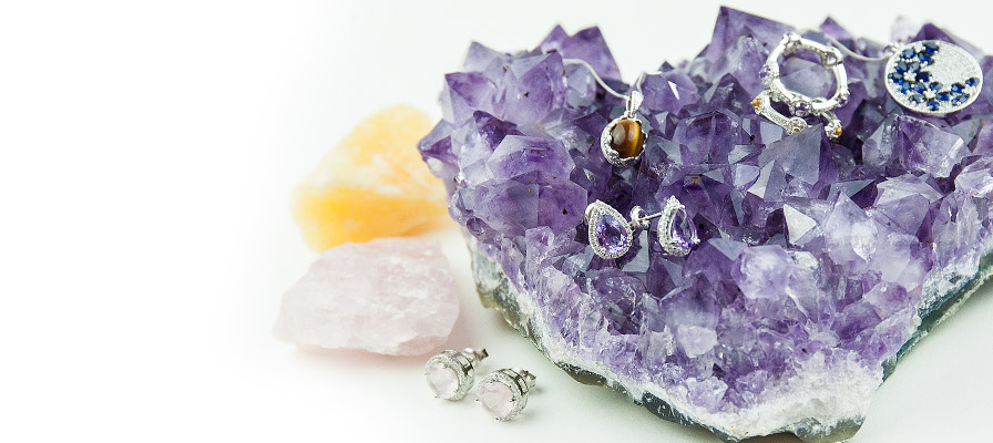 Mineral jewellery - rose quartz earrings, amethyst earrings, tiger's eye pendant, citrine and amethyst stacking rings, sapphire pendant on a piece of unique quartz
