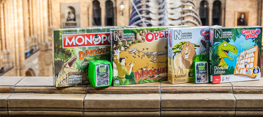 A row of NHM games in Hintze Hall including Monopoly Dinosaurs, Operation Dinosaur and Guess Who Dinosaur