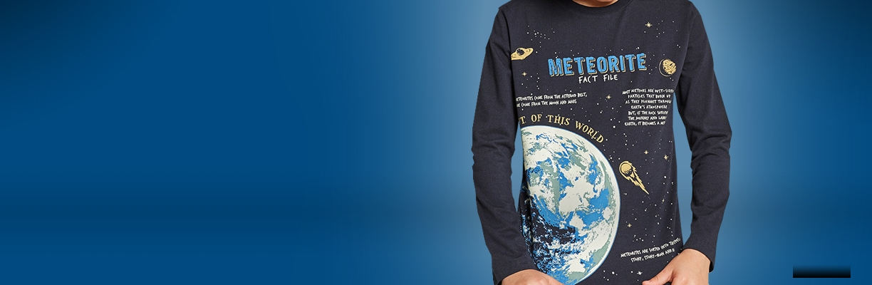 Boy in Meteorites t-shirt on blue background