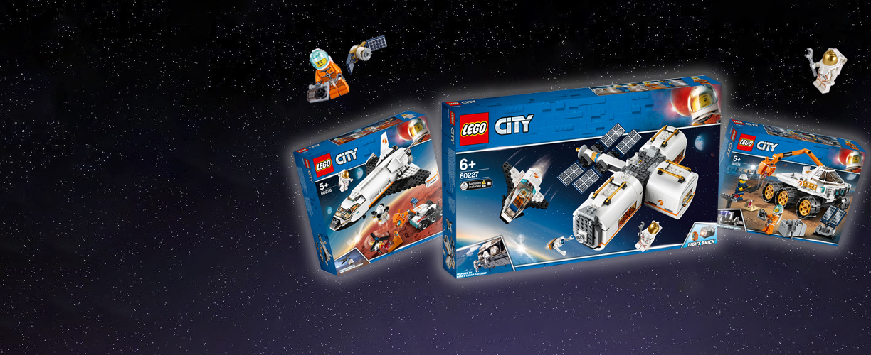 Three LEGO® City Space sets alongside two LEGO® astronauts on a space background