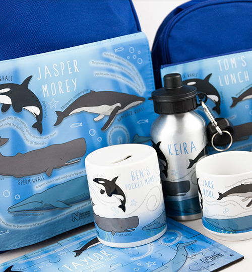 Personalised backpack, lunchbag, puzzle and mug all with a whales design | NHM shop