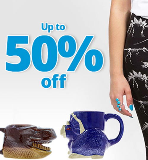two dino mugs facing each other under text that says up to 50% off. There is a little bit of a model in dinosaur leggings showing on the right hand side | NHM shop