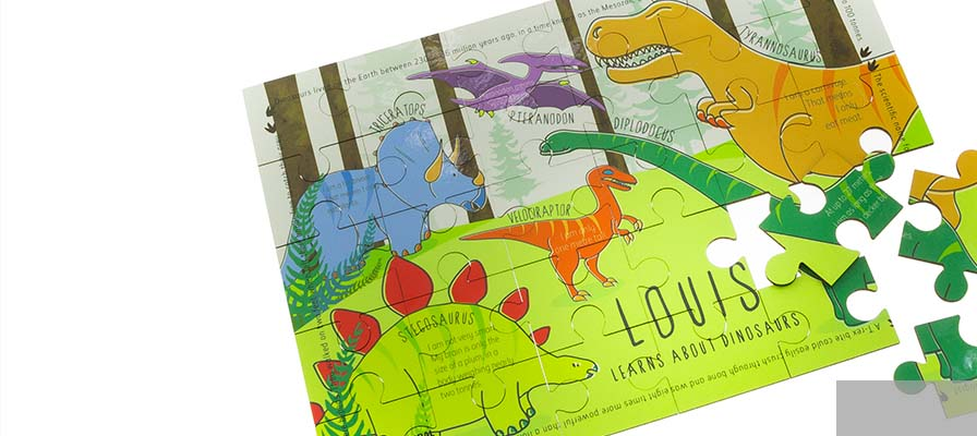 Personalised dinosaur jigsaw puzzle with the name 'Louis' on it