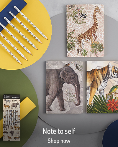 Three animal themed notebooks and a set of pencils sit on a grey background, with yellow and green. The text reads 'Wall prints. Shop now.'